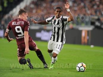 September 23, 2017 in Turin - Allianz Stadium Soccer match Juventus F.C. vs F.C. TORINO In picture: Douglas Costa vs. Andrea Belotti